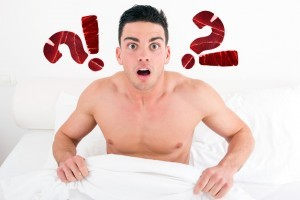 Shirtless man shocked in bed