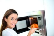 Woman microwaving food
