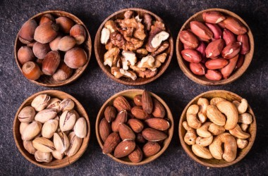 Variety of nuts which are healthy fatty foods in bowls