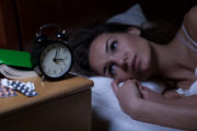 Woman can't sleep stares at clock