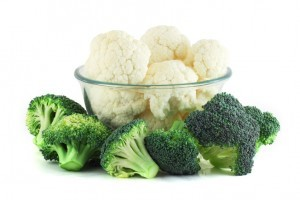 Cauliflower in transparent bowl and broccoli isolated on white