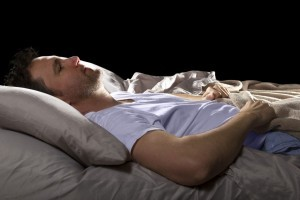 Guy laying in bed sleeping