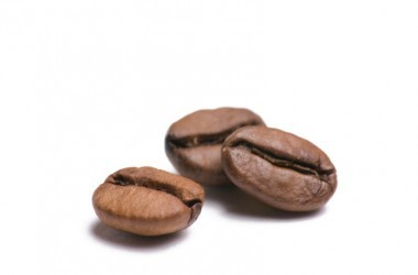 Three coffee beans illustrate drinking coffee benefits