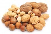 Mixed nuts in shells on white background