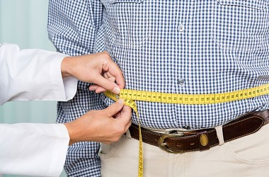 Man battling weight problem has waist measured and could use some weight loss tricks