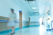 Patient strolling through hospital hallway used a hospital checklist to reduce stress