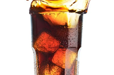 Glass of soda laced with HFCS or high fructose corn syrup