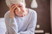 Senior woman suffering with depression from coronavirus isolation
