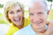 Smiling mature happy man and woman