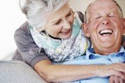 Older couple laughing together.