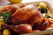 Whole roasted chicken served with roasted vegetables