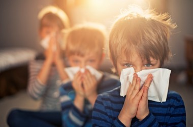 Sneezing kids with a cold or flu