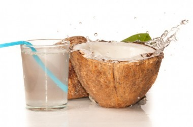 Coconut water with coconut on white background