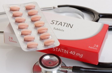 A generic pack of statin drugs a cholesterol medication with a stethoscope underneath.