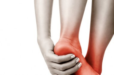 High blood sugar caused neuropathy or diabetic nerve pain in woman's foot