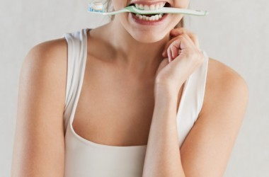 Beautiful woman with toothbrush for dental health