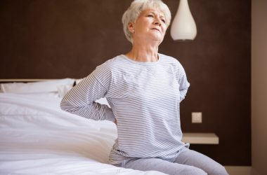 Senior woman looking for knee and back pain relief