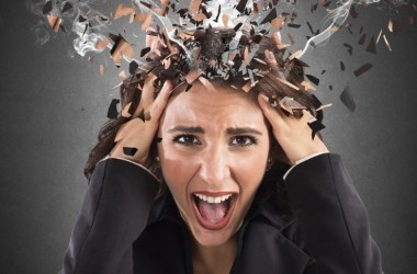 Stressed woman with exploding smoking head needs to relieve chronic stress hormone levels