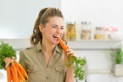 woman eating carrots with fountain of youth carotenoids to fight metabolic syndrome