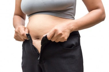 Overweight woman with big belly needs metabolism boosters