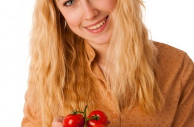 Woman holding superfood tomatoes