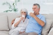 Attractive senior couple drinking full-fat dairy milk whole milk