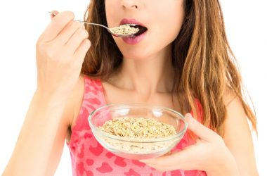 Woman eating instant oatmeal with glyphosate pesticides