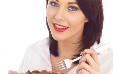 woman eating curry with turmeric to control blood sugar spikes