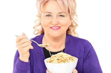 woman eating one of the worst foods for breakfast cold cereal