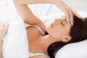 woman trouble sleeping headache and night sweats