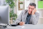 man who needs an energy boost sleeps at desk