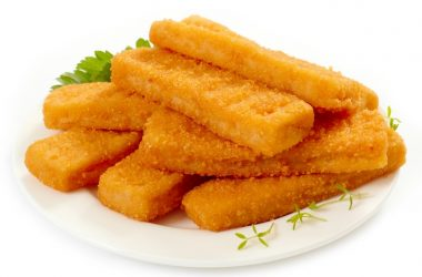 fish sticks with allergy linked food preservative tBHQ on white plate