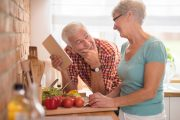Senior Couple Cooking Healthy Food and eating healthier