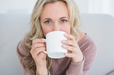 Woman drinking anti-aging coffee
