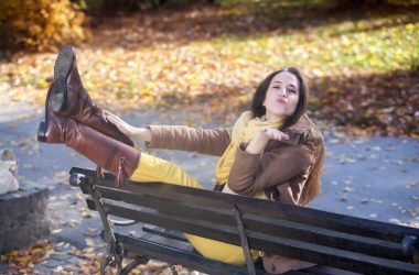 Young woman blowing a kiss in park happy to not have any more joint pain