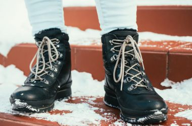 Female feet in winter boots with laces