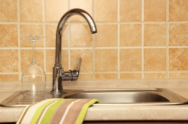 Kitchen sink with a kitchen towel which may harbor bacteria