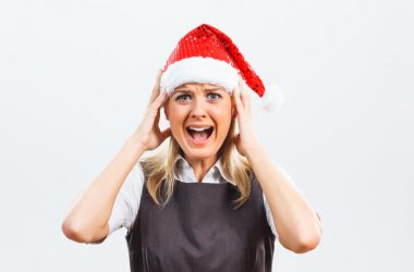 Woman in Santa hat suffering from holiday stress and anxiety