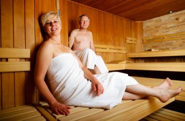 Seniors in sauna sweating and relaxing