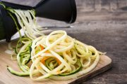 Veggie spiralizer making zucchini and carrot noodles