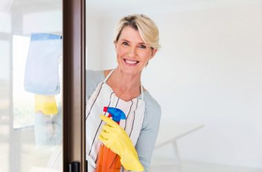 Woman doing house cleaning with natural cleaners instead of chemical cleaners