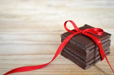 Pile of dark chocolate with red ribbon