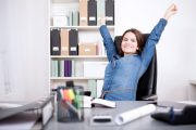 Woman doing chair exercises at her desk