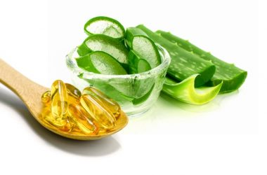 Aloe vera leaves and a spoon of vitamin E pills to help heal scars