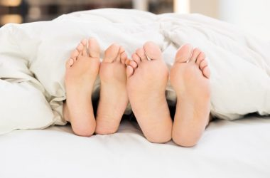 Couples feet in bed to illustrate libido boosting and having more sex