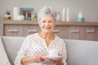 Smiling senior woman enjoying the health benefits of coffee drinking