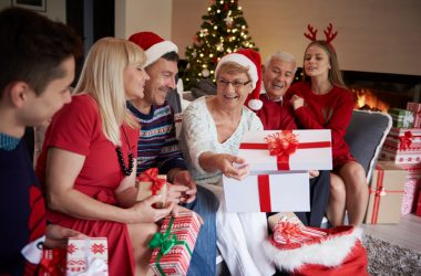 Family opening gifts on a stress free Christmas Day