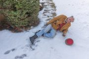 Senior man slips and falls on ice on his sidewalk