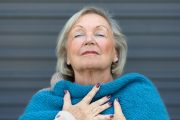 Senior woman breathing deeply after avoiding lung problems breathing problems asthma
