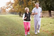 Senior couple briskly walking and experiencing the brain boosting power of exercise